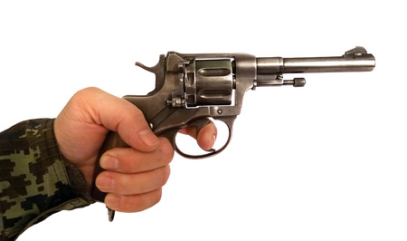 Old revolver in his left male hand, which finger on the trigger before firing the shot Stock fotó