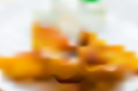 ed: Abstract blurry, blurred vector background of potatoes, cream and plate. Soft focus background, element