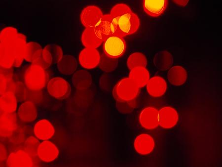 defocus: Spots of defocused red night lights on black backdrop; Template  texture with copyspace; Landscape format