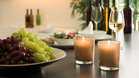 Fresh red and green grapes in a front of a table of guests; Close up shot on natural light