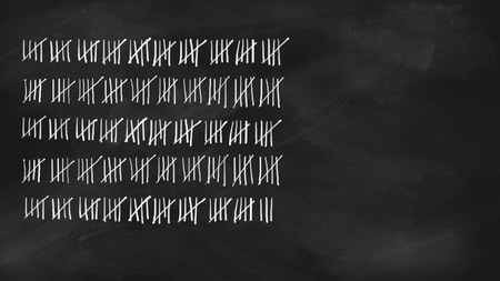 Five series tally sheet chalk lettering with 248 lines jotted on a black vintage chalkboard; wide copy space with no people