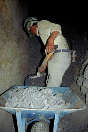 life saving: A worker searches for life saving silver in the mine shafts of Potosi, Bolivia