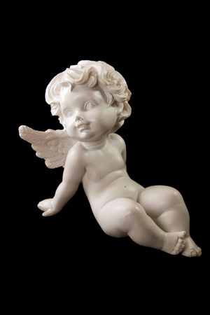 Angel statuette on a black background photo