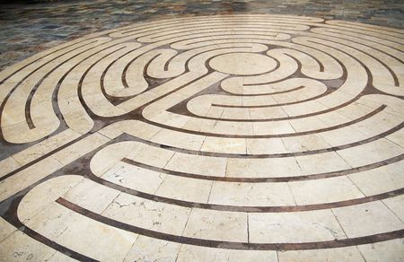 labyrinth: Concentric circles engraved in the ground, shaping a labyrinth. This representation was shot on the place de la poisonnerie square at Grasses city, close to Cannes, on the french riviera.