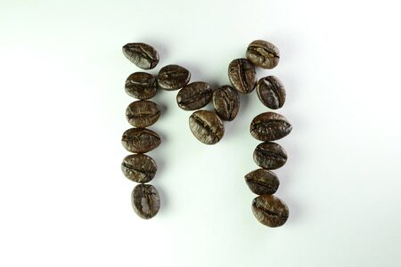 letter M with coffee beans