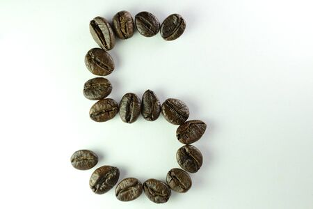 Coffee Beans, the number five is formed with coffee beans in white background Stok Fotoğraf
