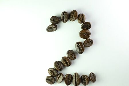 Coffee Beans, the number two is formed with coffee beans in white background