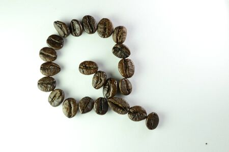 Coffee Beans, the alphabet Q is formed with coffee beans in white background Banco de Imagens