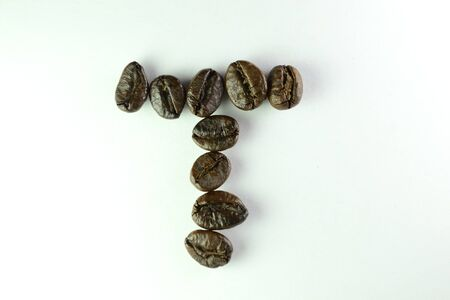 Coffee Beans, the alphabet W is formed with coffee beans in white background