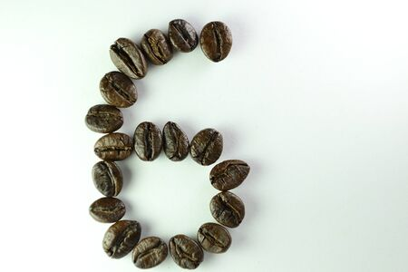 Coffee Beans, the number six is formed with coffee beans in white background