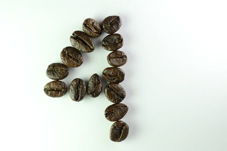 Coffee Beans, the number four is formed with coffee beans in white background Banco de Imagens