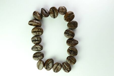Coffee Beans, the number zero or nol is formed with coffee beans in white background Banco de Imagens