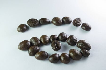 Coffee Beans, the eye formed with coffee beans in white background