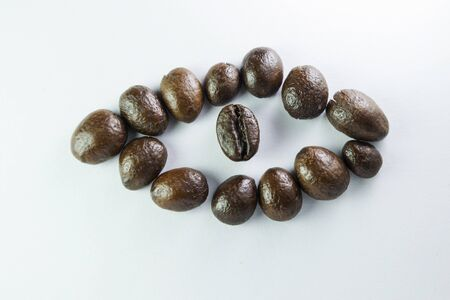 Coffee Beans, the eye is formed with coffee beans in white background