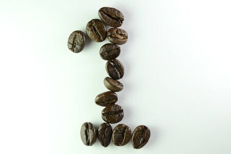 Coffee Beans, the number one is formed with coffee beans in white background Banco de Imagens