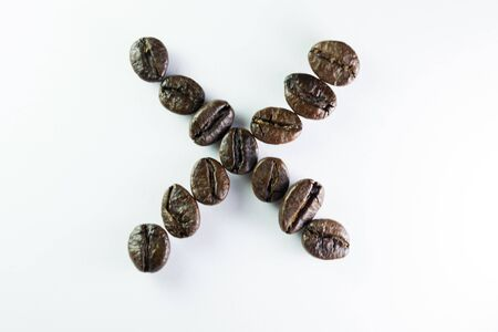 Coffee Beans, the alphabet X is formed with coffee beans in white background