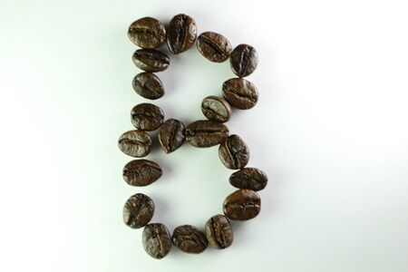 Coffee Beans, the alphabet B is formed with coffee beans in white background Banco de Imagens