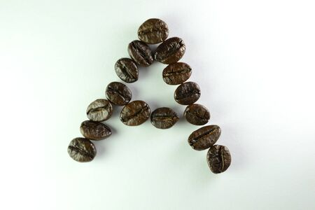 Coffee Beans, the alphabet A is formed with coffee beans in white background Banco de Imagens