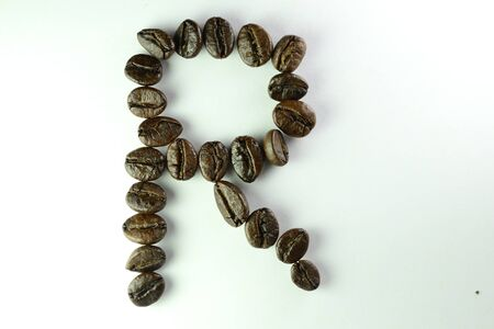Coffee Beans, the alphabet R is formed with coffee beans in white background