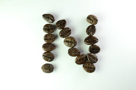 Coffee Beans, the alphabet N is formed with coffee beans in white background