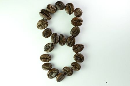 Coffee Beans, the number eight is formed with coffee beans in white background