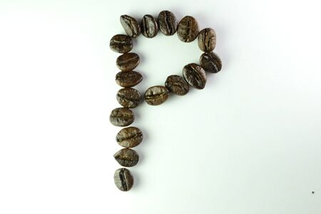 Coffee Beans, the alphabet P is formed with coffee beans in white background