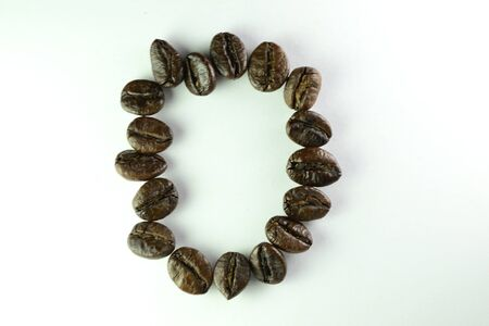 Coffee Beans, the alphabet O is formed with coffee beans in white background