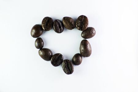 Coffee Beans, Love is formed with coffee beans in white background Banco de Imagens