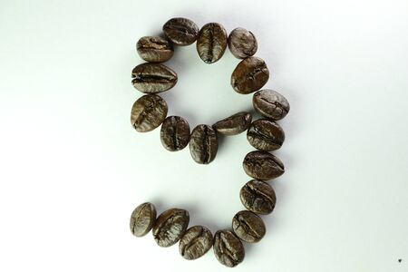 Coffee Beans, the number nine is formed with coffee beans in white background