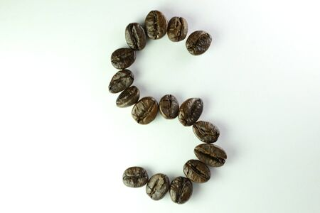 Coffee Beans, the alphabet S is formed with coffee beans in white background Banco de Imagens