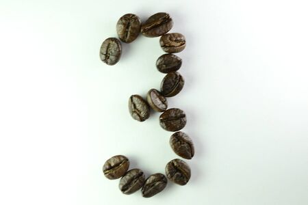 Coffee Beans, the number three is formed with coffee beans in white background