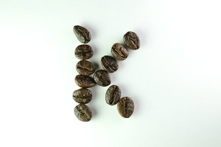 Coffee Beans, the alphabet K is formed with coffee beans in white background