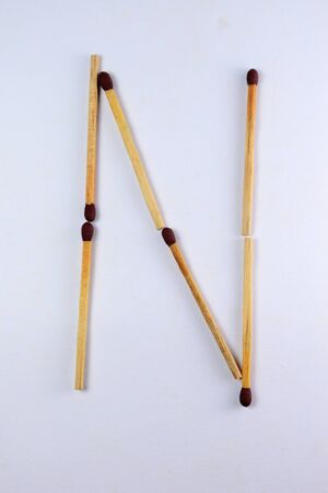Alphabet N with matches in white background