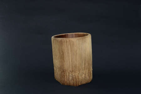 A unique bamboo glass on a black background