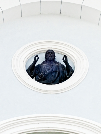 god s hand: The sculpture Jesus Christ is located on facade wall of the Transfiguration Cathedral  Sumy, Ukraine