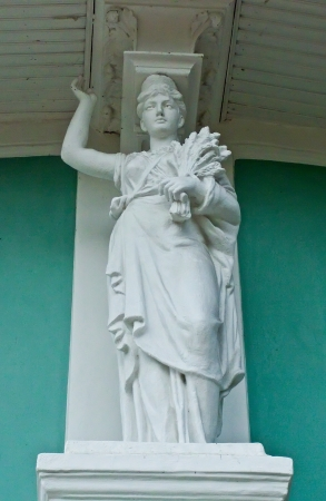 lithic: Statue of a woman with ears decorates the building Local History Museum in Sumy, Ukraine
