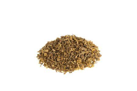 Pile of dried Rhubarb, Rheum rhabarbarum shredded roots isolated on white background, used to make tea.