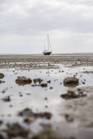 Fisherman boats stuck on the beach in low tide period in Leigh-on-Sea, UK.