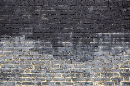 Old grey brick wall background texture close up.