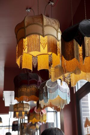A textile chandelier shining by yellow light.