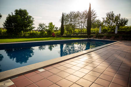 Outdoor swimming pool on the open air with beautiful view to the garden.