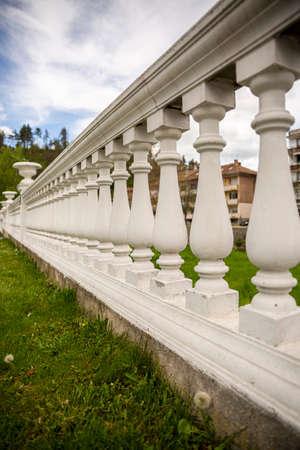 Fragments of white marble stone railings. Bridge guardrail.