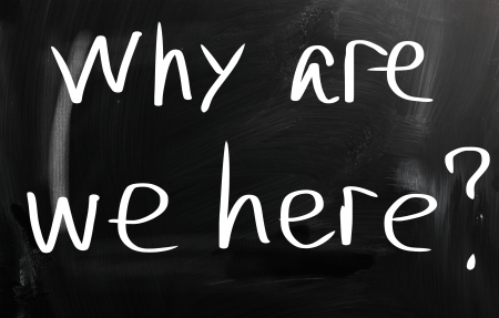 why are we here handwritten with white chalk on a blackboard Stock Photo