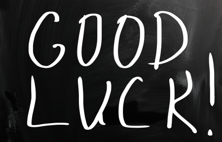 Good luck   handwritten with white chalk on a blackboard photo