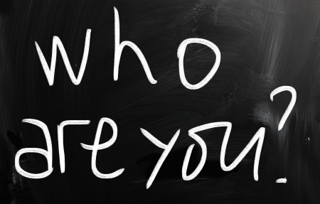 Who are you handwritten with white chalk on a blackboard