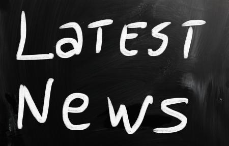 happening: Breaking news handwritten with white chalk on a blackboard Stock Photo