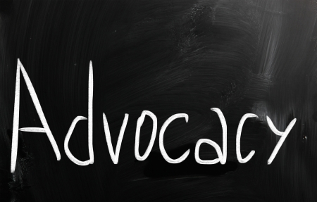 The word 'Advocacy' handwritten with white chalk on a blackboard Stock Photo - 20007122