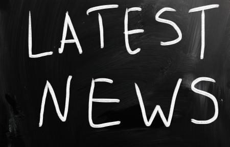 Latest news handwritten with white chalk on a blackboard photo