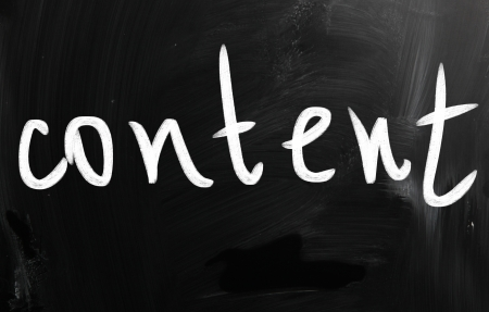 meta tags: The word Content handwritten with white chalk on a blackboard