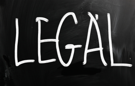 The word 'Legal' handwritten with white chalk on a blackboard photo